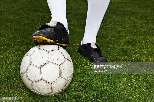 Legs of a soccer player, close-up