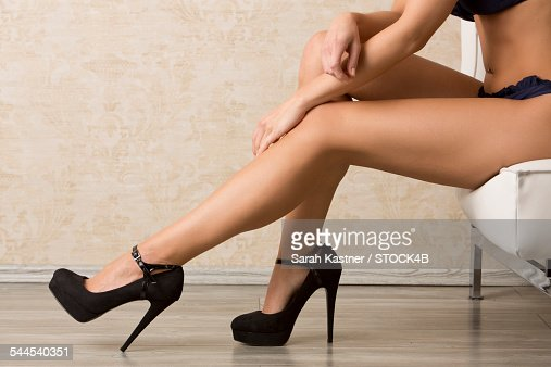 Legs Of A Woman Wearing High Heels Stock Photo | Getty Images