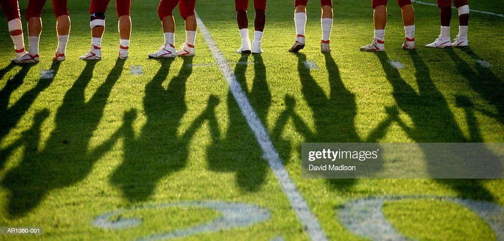 Legs of American football players on field, (Digital Enhancement) : Stock Photo
