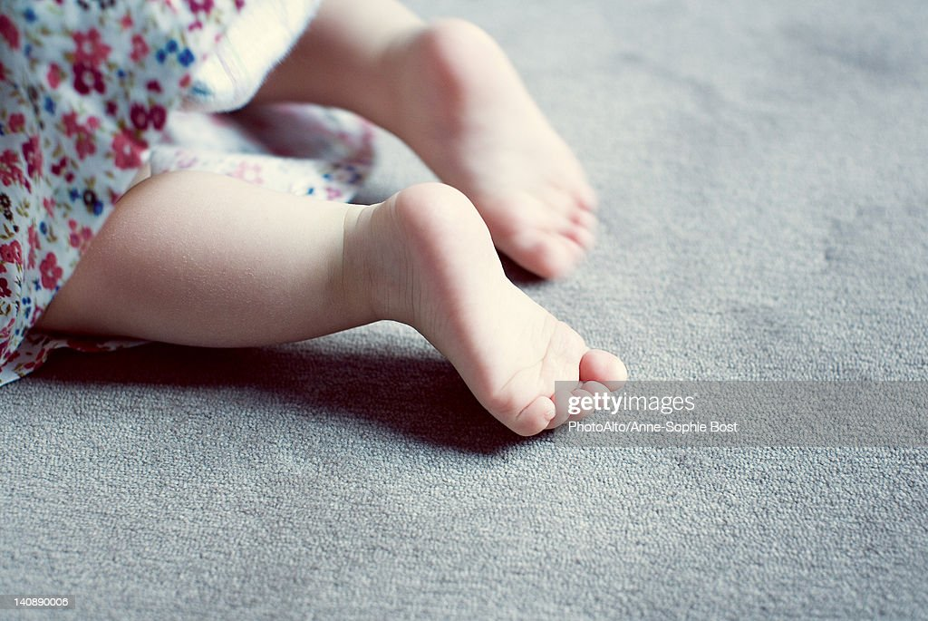 Legs of baby girl, cropped