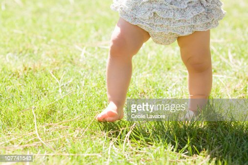 Legs of baby girl walking