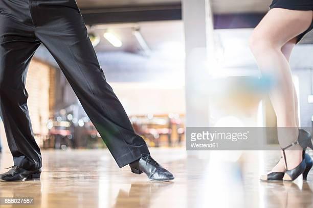 Legs of dancing couple in studio