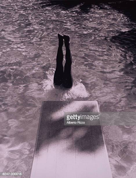 Legs of Diver in Pool