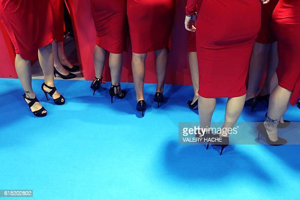 Legs of hostesses are pictured during the world's entertainment content market on October 17 2016 in Cannes southeastern France / AFP / VALERY HACHE