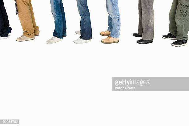 Legs of people in a row