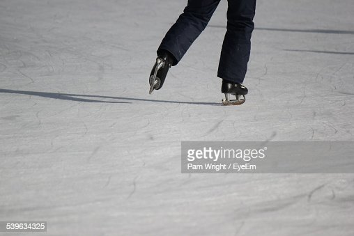 Legs Of Person Ice Skating Stock Photo
