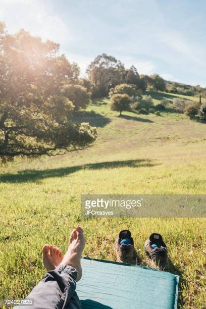 Legs of person relaxing and enjoying view of hills, Fairfax, California, US