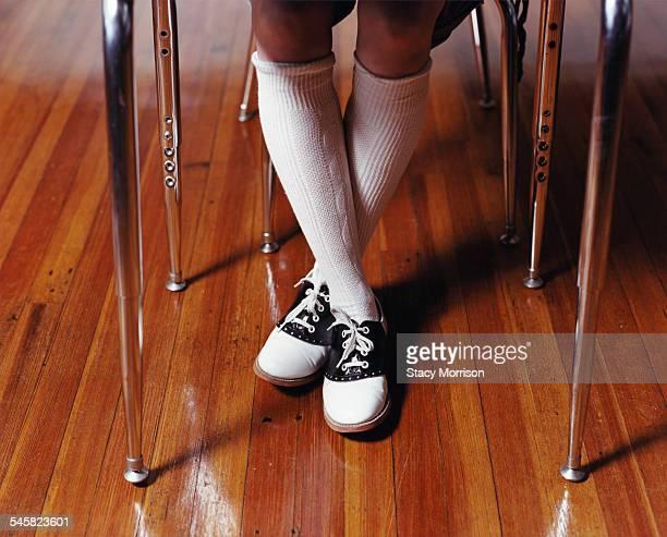 Legs of Schoolgirl Under Desk