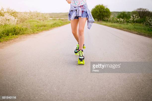 Legs of teenager having roller skate exercise in nature