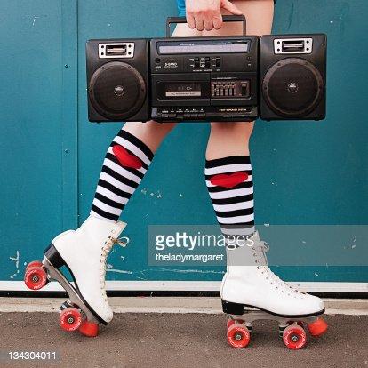 Legs of woman wearing white roller skates