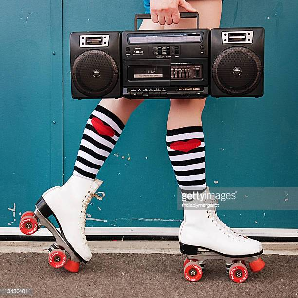 Legs of woman wearing white roller skates