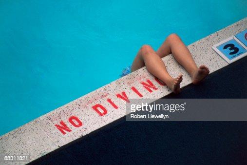 Legs on edge of pool