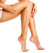 Legs Smooth Skin, Woman Touching Hairless Leg, Female Beauty Care and Hair Removal, Sexy Body Isolated on White Background