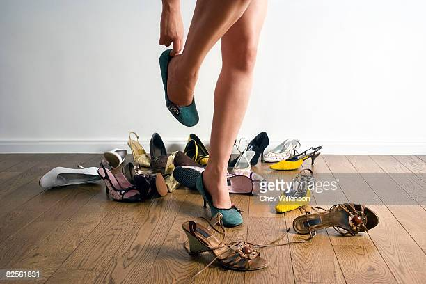 Legs surrounded by shoes