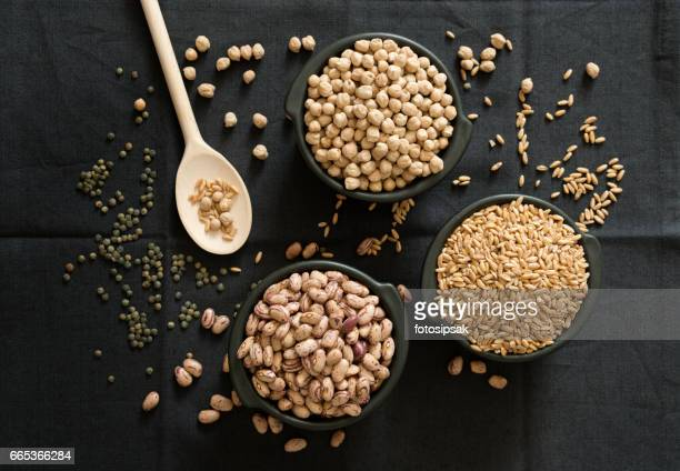 legume family in the black bowls on the table