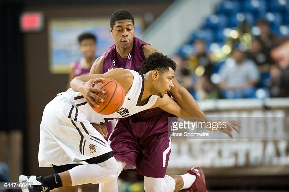 Lehigh Guard Brandon Alston keeps the ball from Colgate Guard Jordan Robertson in the second half during the game between the Lehigh University...