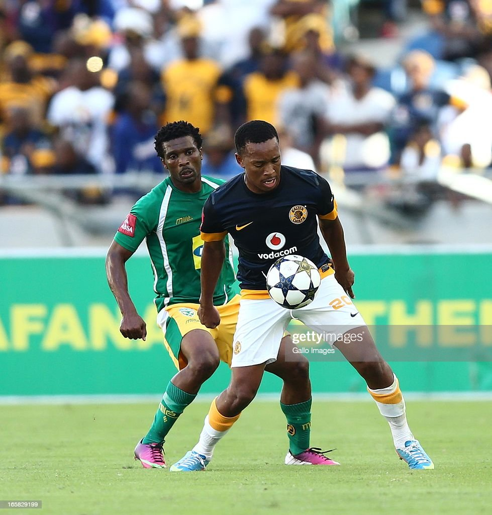 Lehlohonolo Majoro holds off Mzivukile Tom during the Absa Premiership match between Golden Arrows and Kaizer Chiefs at Moses Mabhida Stadium on April 06, 2013 in Durban, South Africa.