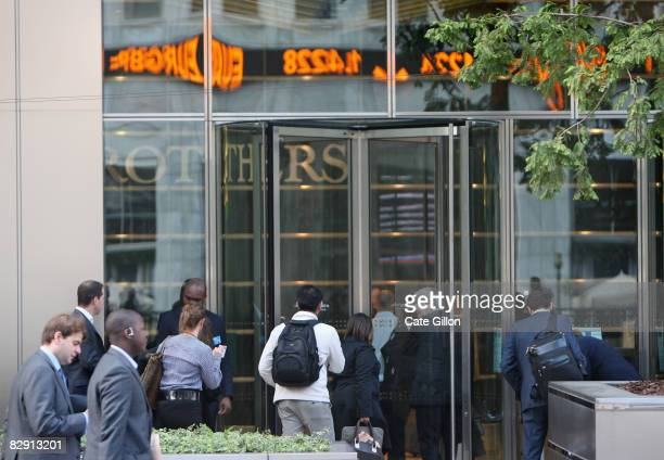 Lehman Brothers' employees arrive at work on September 19 2008 in London England For many employees at the American investment bank today is their...