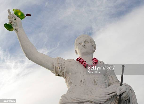 A lei and faux margarita are seen on a statue of Caesar in front of Caesars Palace during the grand opening celebration for the Margaritaville Casino...