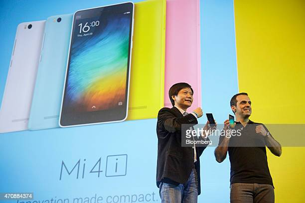 Lei Jun chairman and chief executive officer of Xiaomi Corp left and Hugo Barra vice president of Global Operations hold Mi 4i smartphones for...