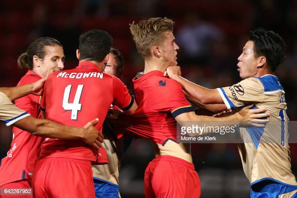 Lei Lei Ma of the Jets pushes Riley McGree of Adelaide United after McGree's tackle on Ma sparked a melee during the round 20 ALeague match between...