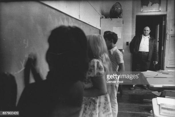Lei visits school and stands in doorway to watch Kuz doing math problem on blackboard He makes regular runs between Sterling Colo and Sidney Neb...