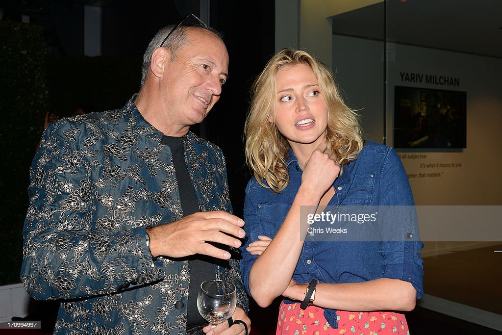 Leica Chief Executive Officer Alfred Schopf (L) and actress <a gi-track='captionPersonalityLinkClicked' href=/galleries/search?phrase=Estella+Warren&family=editorial&specificpeople=214695 ng-click='$event.stopPropagation()'>Estella Warren</a> attend G-Star RAW unveils RAW Leica at the Leica store opening on June 20, 2013 in West Hollywood, California.
