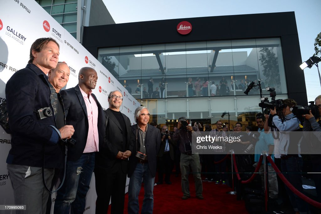 Leica Director of Sales Steffen Keil, Leica Chief Executive Officer Alfred Schopf, Musician Seal, Leica Deputy Chairmain of the Supervisory Board Dr. Andreas Kaufmann, and photographer Nick Ut attend G-Star RAW unveils RAW Leica at the Leica store opening on June 20, 2013 in West Hollywood, California.