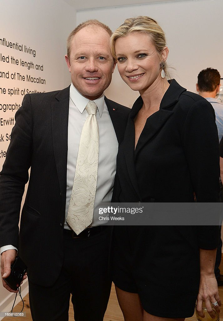 Leica Store Los Angeles manager James Agnew and actress <a gi-track='captionPersonalityLinkClicked' href=/galleries/search?phrase=Amy+Smart&family=editorial&specificpeople=239532 ng-click='$event.stopPropagation()'>Amy Smart</a> attend The Macallan Masters of Photography: Elliott Erwitt at Leica Gallery Los Angeles on October 24, 2013 in Los Angeles, California.