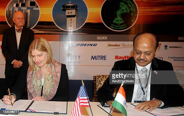 Leicadua Zak director of the US Trade and Development Agency and Airport Authoritiy of India Director VP Agarwal sign an ageement during the USIndia...