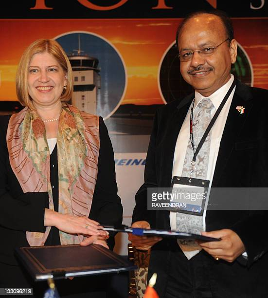 Leicadua Zak director of the US Trade and Development Agency and Airport Authoritiy of India Director VP Agarwal exchange files after an ageement...