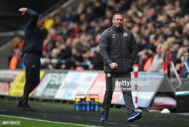 Leicester caretaker Manager Michael Appleton celebrates the first Leicester goal as Swansea manager Paul Clement reacts during the Premier League...