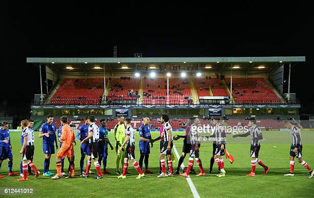 Leicester City and Grimsby Town shake hands ahead of the checkatrade Trophy match between Grimsby Town and Leicester City at Blundell Park on...