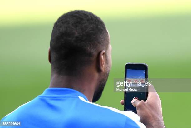 Leicester City Captain Wes Morgan uses snapchat inside the stadium during a Leicester City training session ahead of their UEFA Champions League...