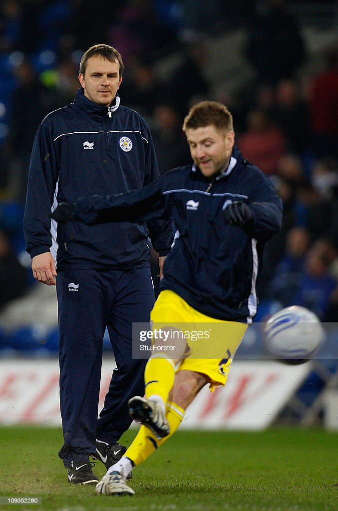 Leicester City coach <a gi-track='captionPersonalityLinkClicked' href=/galleries/search?phrase=Dietmar+Hamann&family=editorial&specificpeople=204639 ng-click='$event.stopPropagation()'>Dietmar Hamann</a> (l) looks on during the npower Championship match between Cardiff City and Leicester City at Cardiff City Stadium on February 22, 2011 in Cardiff, Wales.