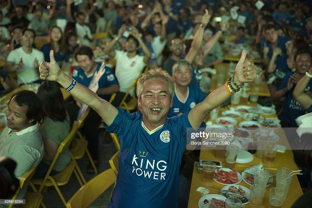 Leicester city fan celebrates a goal while watching his team plays against Manchester United on May 1, 2016 in Bangkok, Thailand. Leicester City fans gather at King Power Hotel in Bangkok to watch the Premier League game between Manchester United and Leicester City at Old Trafford.
