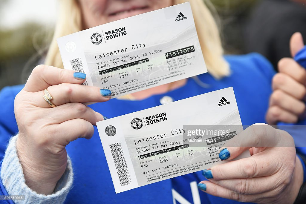 A Leicester City fan displays her match tickets prior to the Barclays Premier League match between Manchester United and Leicester City at Old Trafford on May 1, 2016 in Manchester, England.