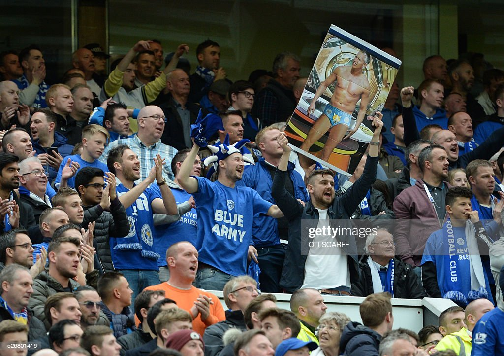 A Leicester City fan holds up a poster showing former Leicester City and England player Gary Lineker, referring to the during the promise he made to to present BBC television programme Match of the Day in his pants if Leicester City win the Premier League title, during English Premier League football match between Manchester United and Leicester City at Old Trafford in Manchester, north west England, on May 1, 2016. / AFP / OLI SCARFF / RESTRICTED TO EDITORIAL USE. No use with unauthorized audio, video, data, fixture lists, club/league logos or 'live' services. Online in-match use limited to 75 images, no video emulation. No use in betting, games or single club/league/player publications. /