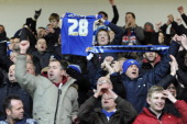 Leicester City fan holds up the replica shirt of goalscorer Kevin Phillips of Leicester City as they celebrate their ninth consecutive win during the...