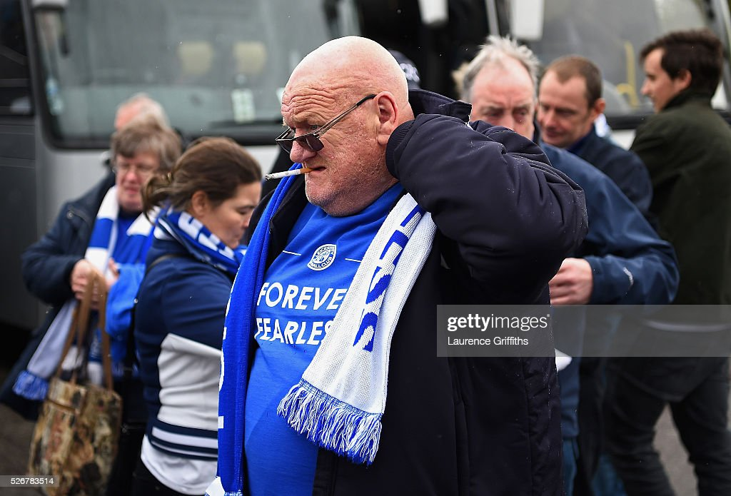 A Leicester City fan looks on as he arrives for the Barclays Premier League match between Manchester United and Leicester City at Old Trafford on May 1, 2016 in Manchester, England.