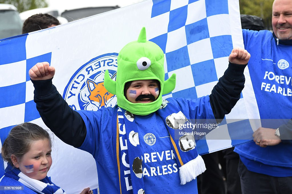 A Leicester City fan poses outside the ground prior to the Barclays Premier League match between Manchester United and Leicester City at Old Trafford on May 1, 2016 in Manchester, England.