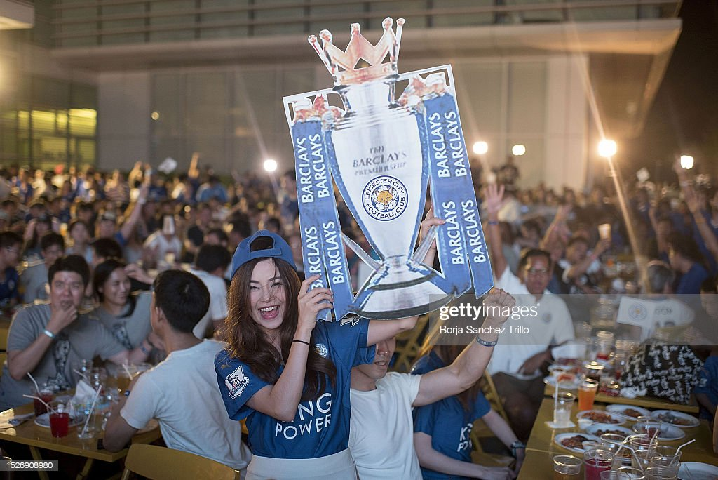 A Leicester City fan reacts after watching her team play against Manchester United at King Power Hotel on May 1, 2016 in Bangkok, Thailand.