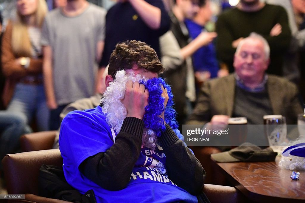 A Leicester City fan reacts as he watches after Tottenham score their second goal in the English Premier League football match between Chelsea and Tottenham Hotspur in a pub in central Leicester, eastern England, on May 2, 2016. Leicester City's remarkable football season could see them crowned champions of England for the first time in their 132-year history without kicking a ball on May 2 if second-placed Tottenham Hotspur fail to keep the Premier League title race alive. Anything less than a Spurs victory away to London rivals Chelsea at Stamford Bridge (1900GMT) -- a ground where they haven't enjoyed a league win for 26 years -- will see Claudio Ranieri's men, 5,000/1 outsiders in pre-season, complete a stunning triumph. NEAL