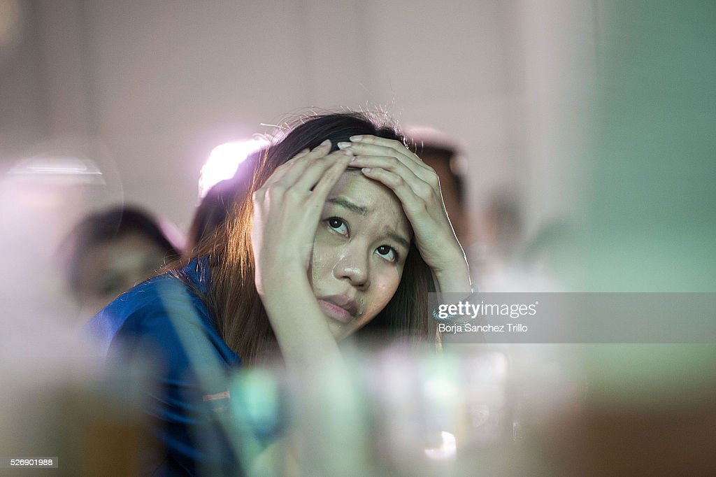 Leicester city fan reacts while watching her team plays against Manchester United on May 1, 2016 in Bangkok, Thailand. Leicester City fans gather at King Power Hotel in Bangkok to watch the Premier League game between Manchester United and Leicester City at Old Trafford.