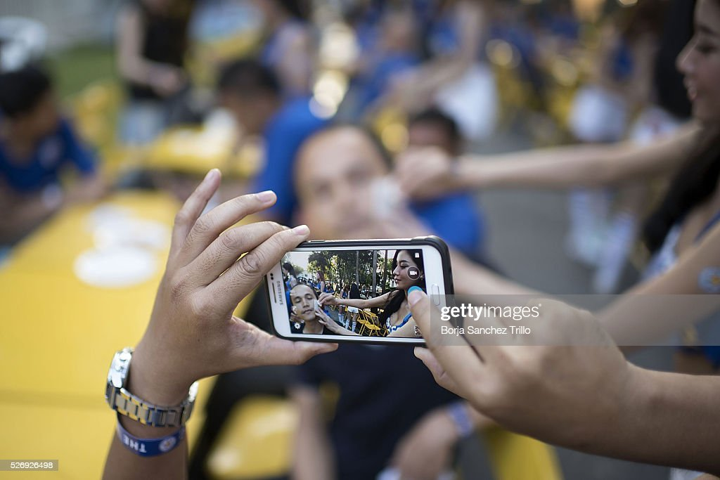 A Leicester city fan takes a picture before watching his team plays against Manchester United on May 1, 2016 in Bangkok, Thailand. Leicester City fans gather at King Power Hotel in Bangkok to watch the Premier League game between Manchester United and Leicester City at Old Trafford.