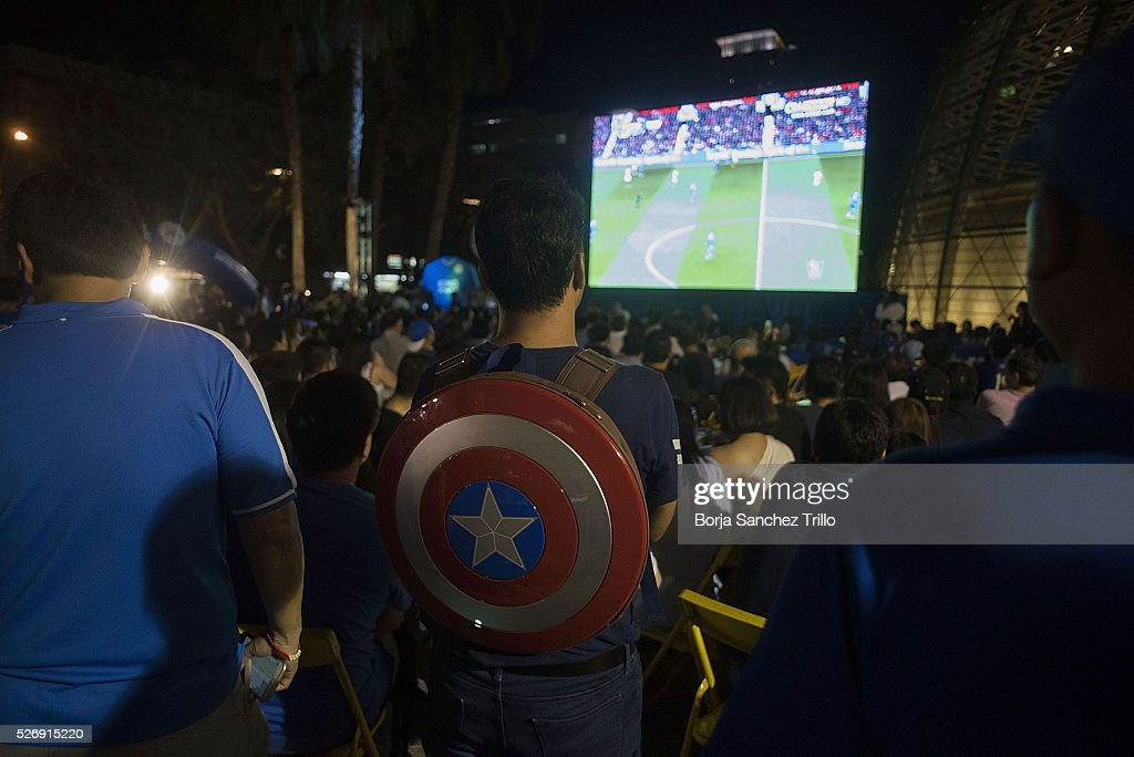 Leicester city fan wears a Captain America shield as he's watching his team plays against Manchester United on May 1, 2016 in Bangkok, Thailand. Leicester City fans gather at King Power Hotel in Bangkok to watch the Premier League game between Manchester United and Leicester City at Old Trafford.