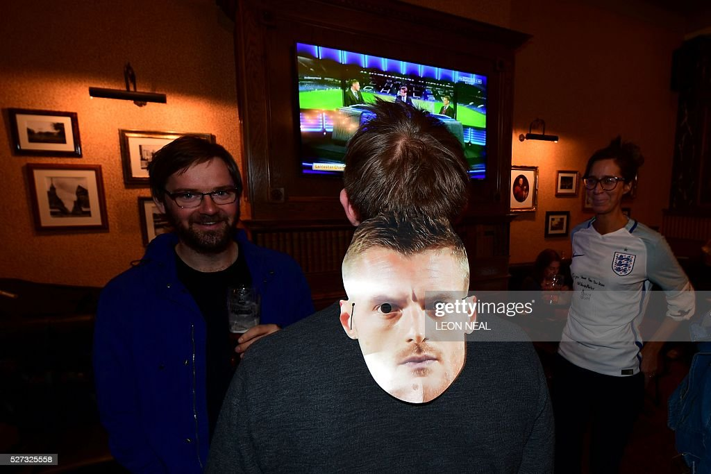 A Leicester City fan wears a mask of their English striker Jamie Vardy in a pub in central Leicester, eastern England, on May 2, 2016 fter Leicester City became the English Premier League football champions. Leicester City completed their fairytale quest for the Premier League title on May 2 after Eden Hazard's stunning late goal earned Chelsea a 2-2 draw with second-place Tottenham Hotspur. NEAL