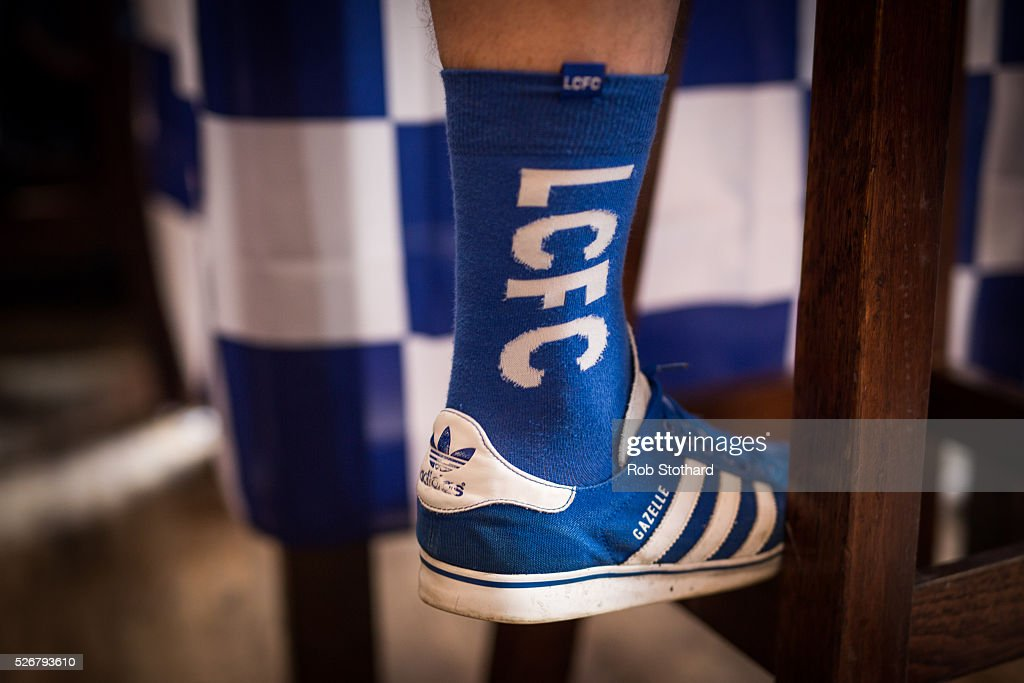 A Leicester City fan wears team socks on May 1st, 2016 in Leicester, England. Leicester City can win the Premier League title today if they beat Manchester United away at Old Trafford in what would be one of the league's most surprising and memoriable moments.
