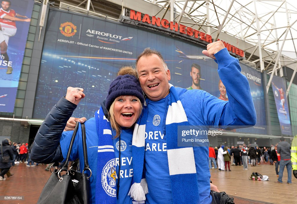 Leicester City fans arrive at Old Trafford ahead of the Premier League match between Manchester United and Leicester City at Old Trafford on May 01, 2016 in Manchester, United Kingdom.