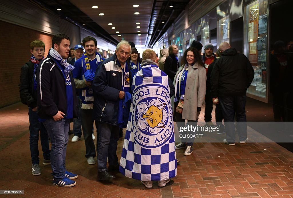 Leicester City fans arrive at Old Trafford stadium before the English Premier League football match between Manchester United and Leicester City in Manchester, north west England, on May 1, 2016. / AFP / OLI SCARFF / RESTRICTED TO EDITORIAL USE. No use with unauthorized audio, video, data, fixture lists, club/league logos or 'live' services. Online in-match use limited to 75 images, no video emulation. No use in betting, games or single club/league/player publications. /